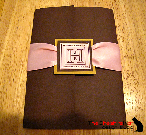 The pocketfolder was handmade from leather-textured paper with a satin ribbon bellyband and monogram.